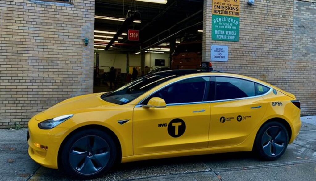 tesla model-3 yellow cab new york taxi